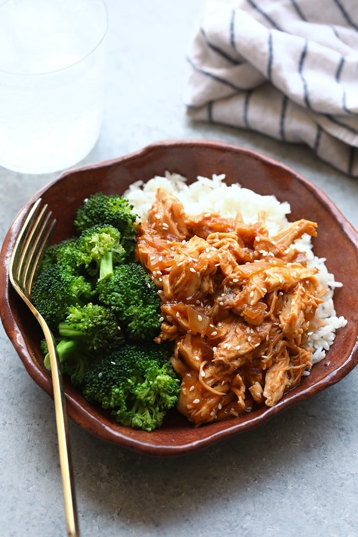 crockpot sesame chicken in a bowl with rice and broccoli